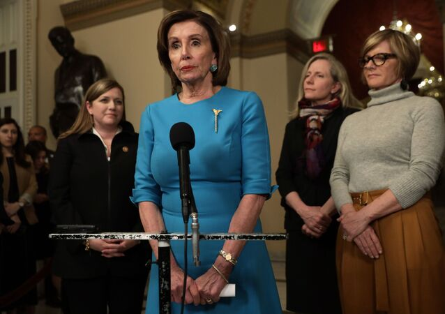 U.S. Speaker of the House Rep. Nancy Pelosi (D-CA) speaks to members of the media as Rep. Lizzie Fletcher (D-TX), Rep. Abigail Spanberger (D-VA) and Rep. Susie Lee (D-NV) listen at the U.S. Capitol March 13, 2020