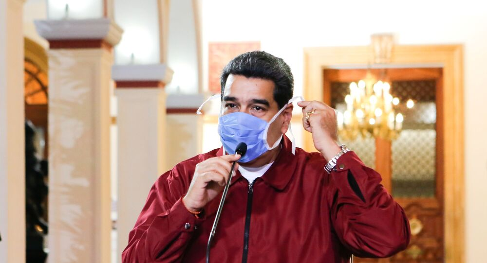 Venezuela's President Nicolas Maduro wears a protective face mask as he speaks during a meeting at Miraflores Palace in Caracas, Venezuela March 13, 2020