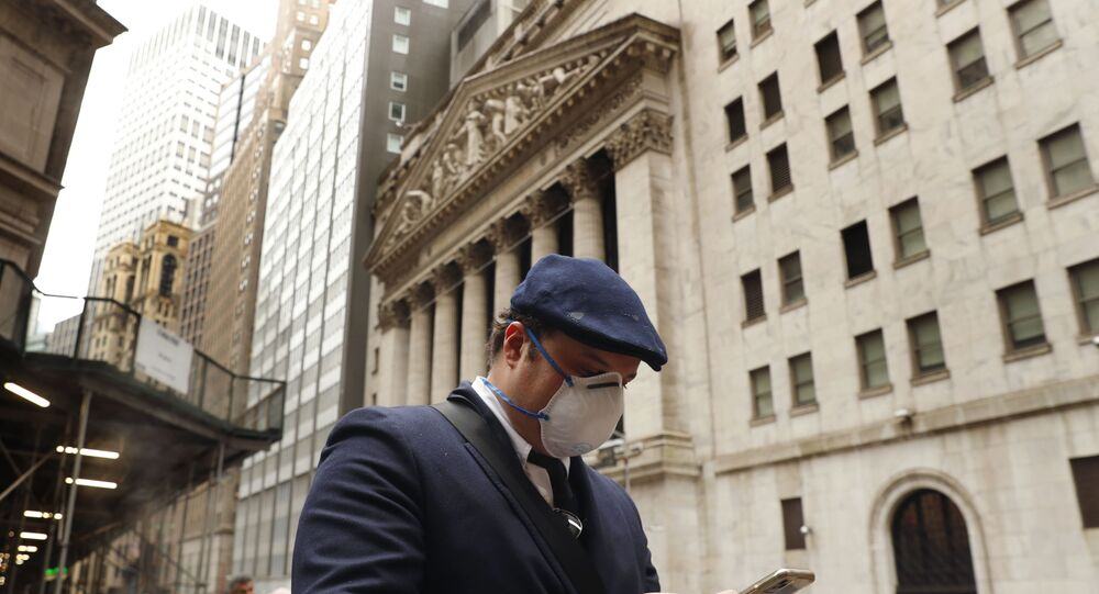 A man wears a protective mask as he walks past the New York Stock Exchange on the corner of Wall and Broad streets during the coronavirus outbreak in New York City, New York, U.S., March 13, 2020