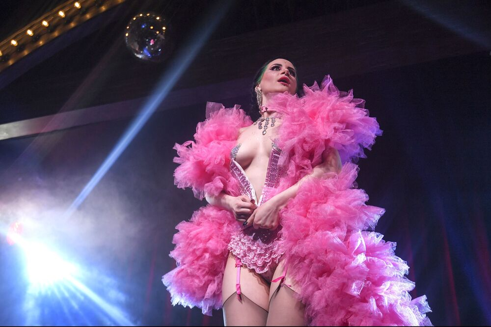 Ladies of Burlesque's Vutrica giving a performance titled 'A bandit girl'.