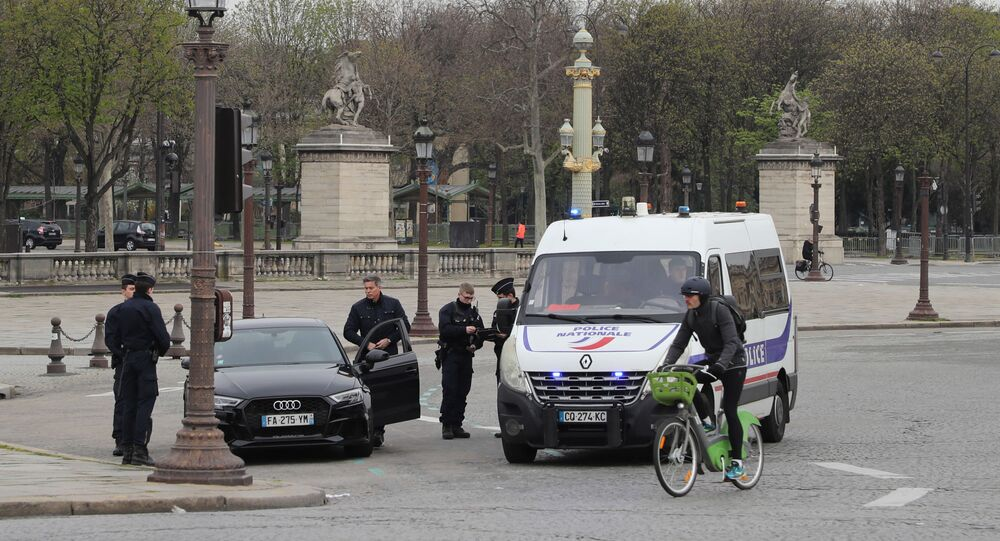 Police officers proceed to control in Paris, on March 17, 2020 a few hours before the order of staying at home to all French citizens comes into effect, in order to avoid the spreading of the novel coronavirus.