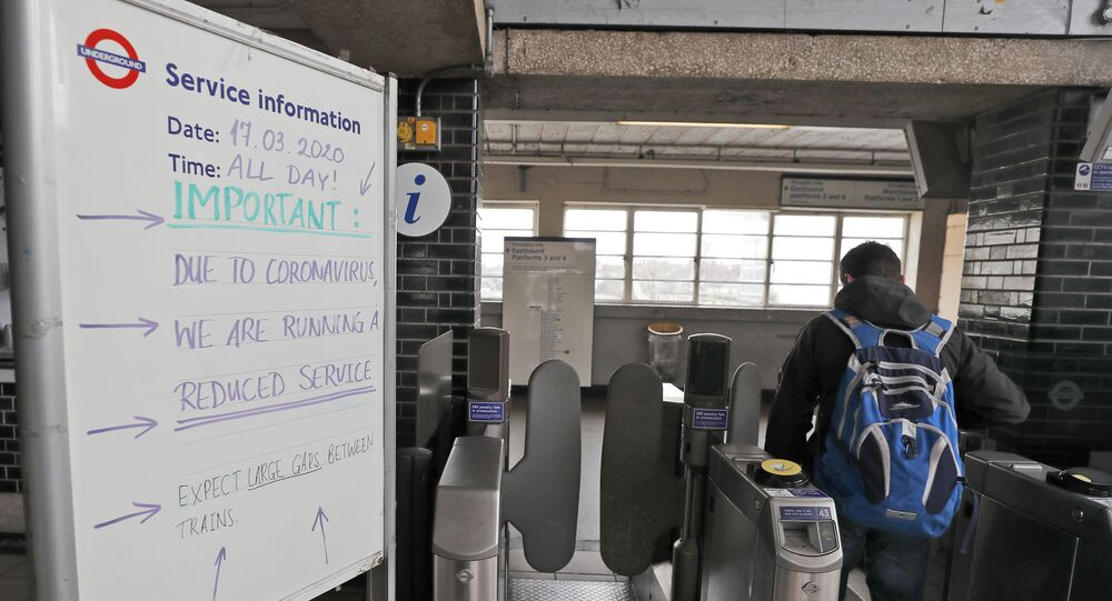 Signs at a London Tube Station notifying the public of a reduced service due to the coronavirus outbreak, Tuesday, 17 March 2020. For most people, the new coronavirus causes only mild or moderate symptoms, such as fever and cough. For some, especially older adults and people with existing health problems, it can cause more severe illness, including pneumonia.