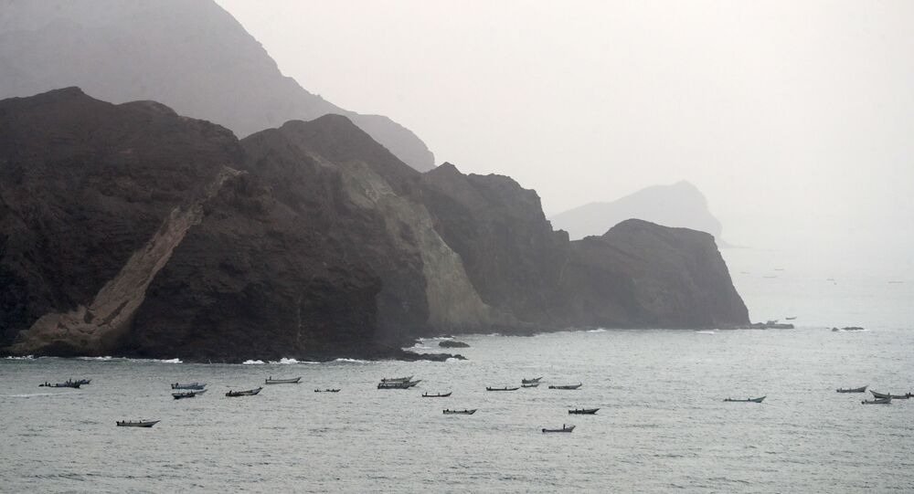 A picture taken on 10 August 2018 during a trip in Yemen organised by the UAE's National Media Council (NMC) shows a view of Yemeni fishing boats along the Yemeni side of the strategic strait of Bab al-Mandab, which separates the Arabian Peninsula from east Africa.