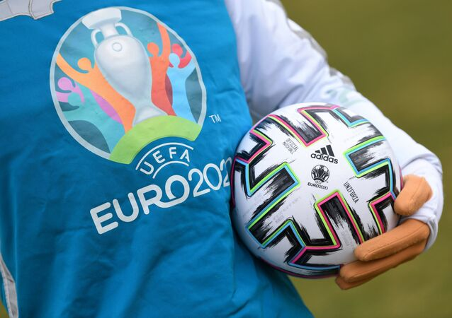UEFA Euro 2020 mascot Skillzy poses for a photo with the official match ball at Olympiapark in Munich, Germany, March 3, 2020