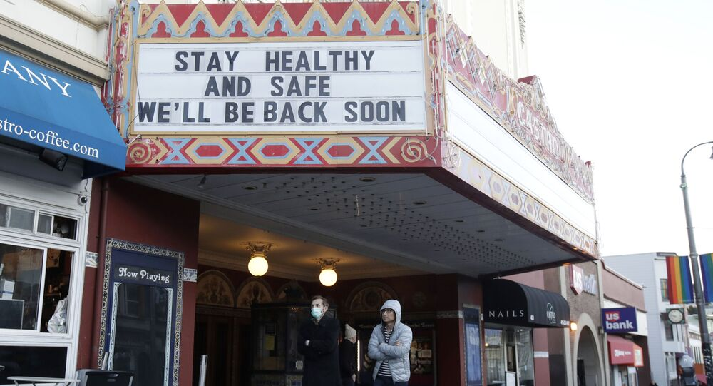 A man wears a mask while walking under the marquee of The Castro Theatre in San Francisco, Monday, 16 March 2020. Officials in six San Francisco Bay Area counties issued a shelter-in-place mandate Monday affecting nearly 7 million people, including the city of San Francisco itself. The order says residents must stay inside and venture out only for necessities for three weeks starting Tuesday in a desperate attempt by officials to curb the spread of the novel coronavirus.