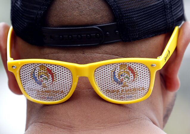 A Colombia fan wears  COPA America 2016 logo glass before a Copa America semifinal soccer match between Colombia and Chile at Soldier Field in Chicago, Wednesday, 22 June 2016
