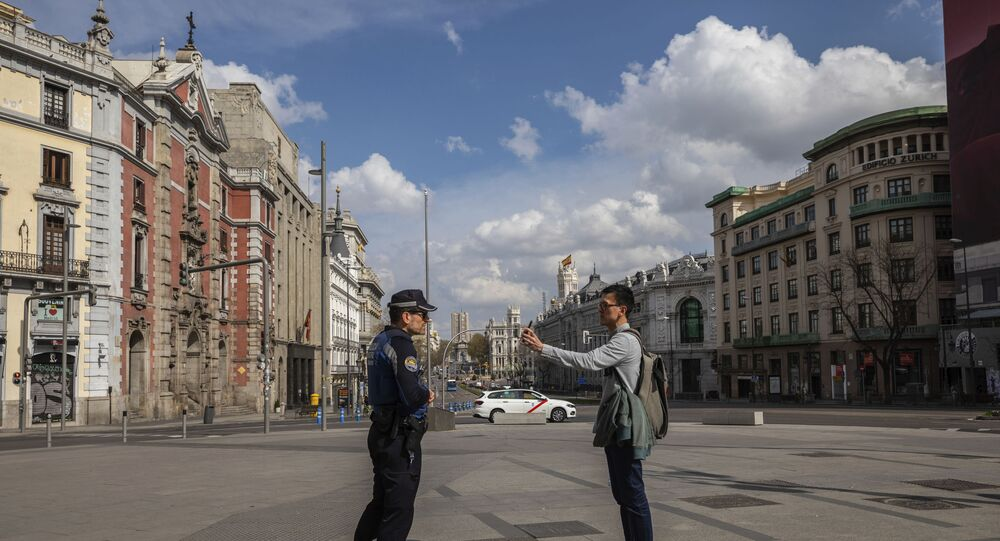 A tourist shows the location of his hotel to a local police in downtown Madrid, Spain, Sunday, March 15, 2020. Spain awoke to its first day of a nationwide quarantine on Sunday after the government declared a two-week state of emergency. The government imposed the special measures including the confinement of people to their homes unless shopping for food and medicine, going to and from work, and to meet other basic needs. The vast majority of people recover from the new coronavirus. According to the World Health Organization, most people recover in about two to six weeks, depending on the severity of the illness.