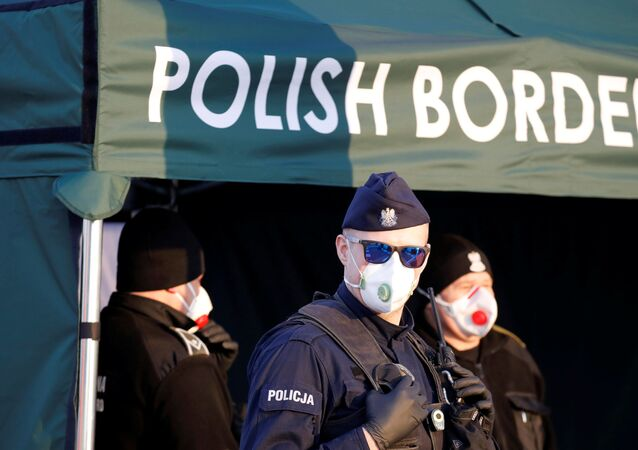 A police officer wearing a protective face mask stands at the border between Germany and Poland in Frankfurt/Oder, Germany March 17, 2020.