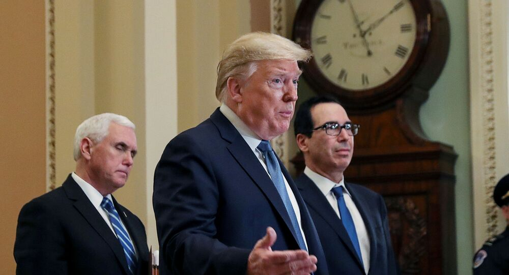 U.S. President Donald Trump is flanked by Vice President Mike Pence and Treasury Secretary Steven Mnuchin as he speaks to members of the news media following a closed Senate Republican policy lunch meeting to discuss the response to the coronavirus outbreak with senators on Capitol Hill in Washington, U.S., March 10, 2020