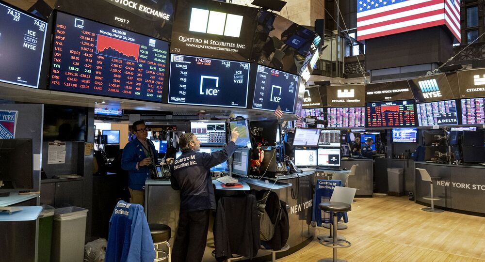 Traders work on the floor of the New York Stock Exchange near the end of the trading day, Monday, March 16, 2020