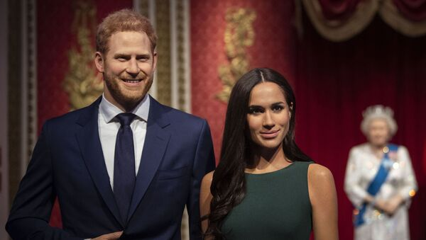 The figures of Britain's Prince Harry and Meghan, Duchess of Sussex, left, are moved from their original positions next to Queen Elizabeth II, Prince Philip and Prince William and Kate, Duchess of Cambridge, at Madame Tussauds in London, Thursday Jan. 9, 2020 - Sputnik International