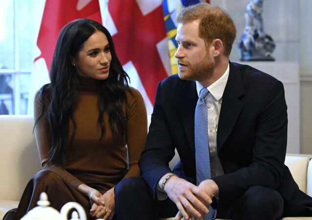 Britain's Prince Harry and Meghan, Duchess of Sussex gesture during their visit to Canada House, thanking the warm Canadian hospitality and support they received during their recent stay in Canada, in London, 7 January 2020