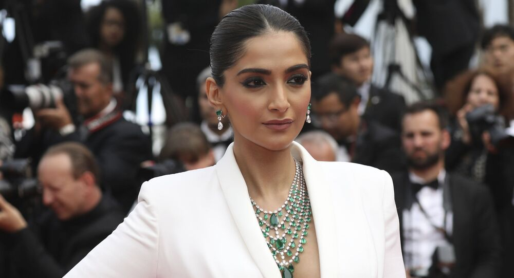 Actress Sonam Kapoor poses for photographers upon arrival at the premiere of the film 'Once Upon a Time in Hollywood' at the 72nd international film festival, Cannes, southern France, Tuesday, May 21, 2019