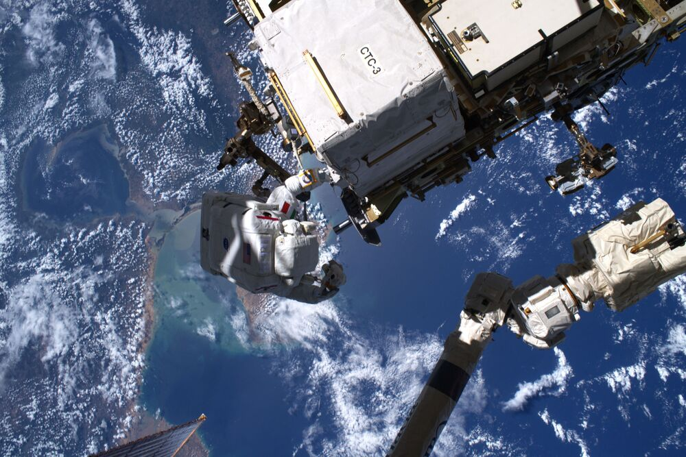 ESA astronaut Luca Parmitano captured flying over the Caribbean by NASA astronaut Andrew Morgan during their third spacewalk to service the Alpha Magnetic Spectrometer AMS-02.