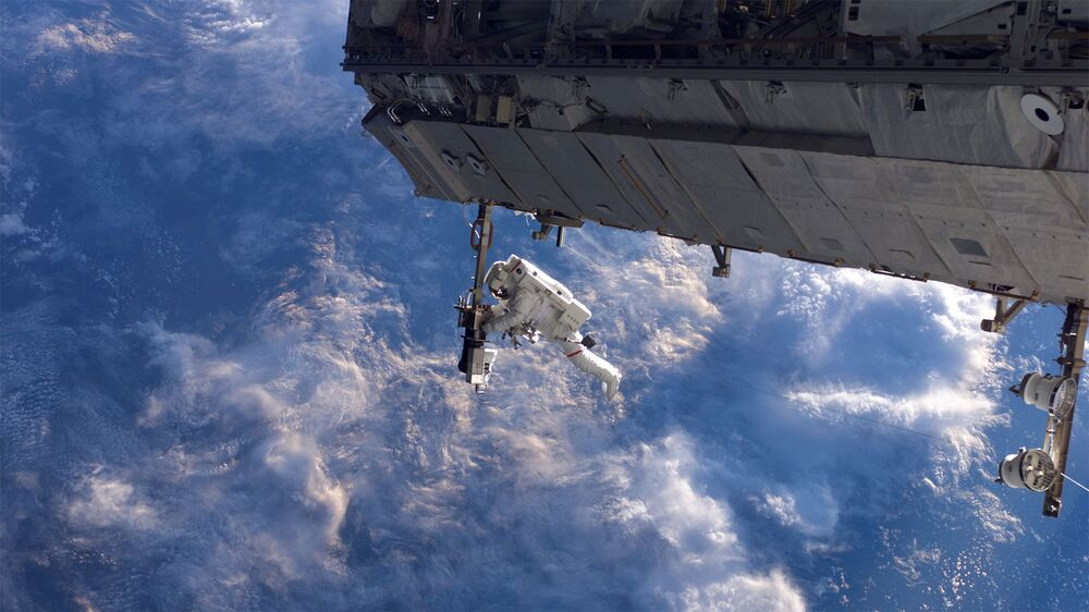 NASA astronaut Robert Curbeam works on the International Space Station's S1 truss during the space shuttle Discovery's STS-116 mission in Dec. 2006. European Space Agency astronaut Christer Fuglesang (out of frame) was his partner in the 6-hour, 36-minute spacewalk.