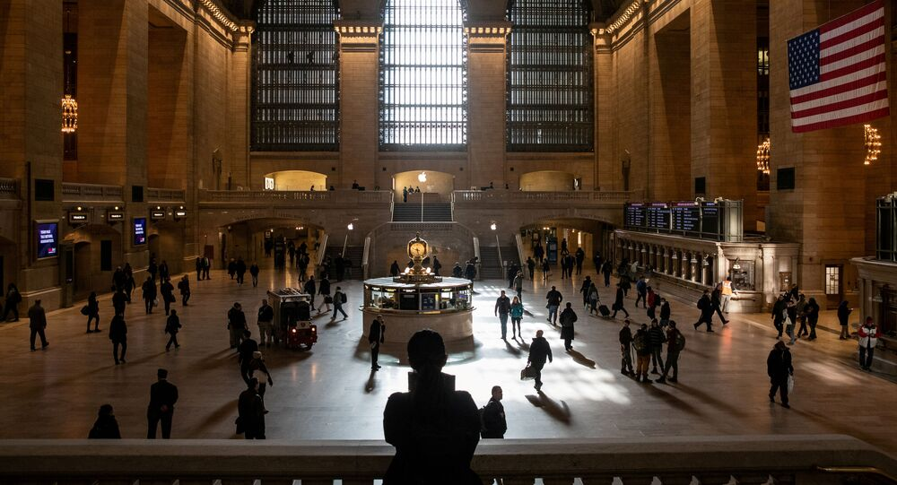 Commuters walk through the lobby of Grand Central Station following the outbreak of coronavirus disease (COVID-19), in New York City, U.S., March 16, 2020.