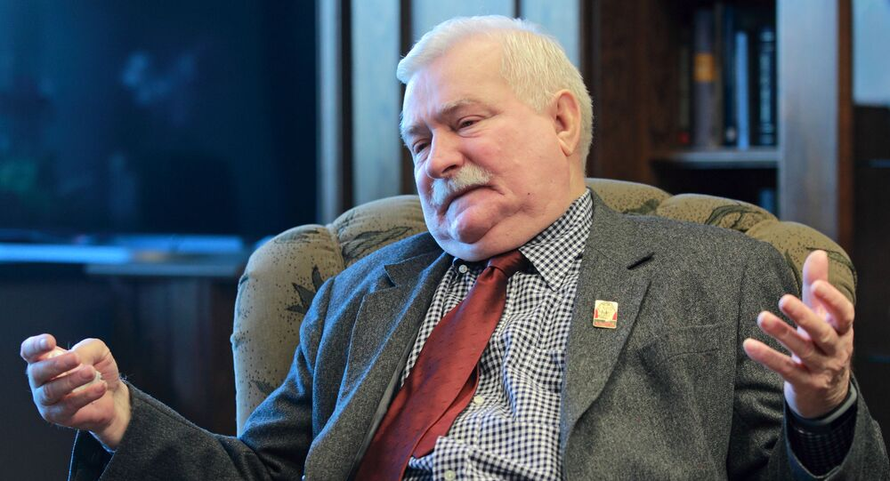 """Poland's former president and legendary Solidarity freedom movement founder Lech Walesa acts with expression as he repeats his denials to allegations he collaborated with the communist regime and talks about the """"crisis of democracy"""" during an exclusive interview with The Associated Press at his new office at the European Solidarity Center in Gdansk, Poland, Wednesday, April 6, 2016"""