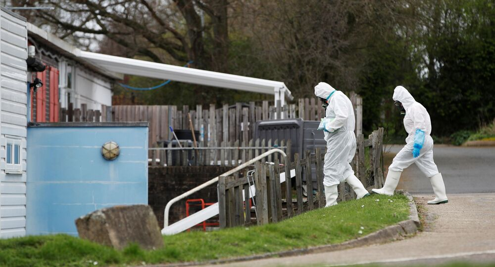 Staff from a cleaning company arrive at Parkside Community Primary School in Borehamwood as the spread of the coronavirus disease (COVID-19) continues, in Boreham Wood, Britain, March 18, 2020.
