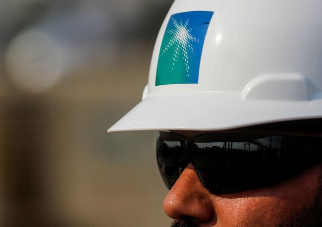 An employee in a branded helmet is pictured at Saudi Aramco oil facility in Abqaiq, Saudi Arabia October 12, 2019