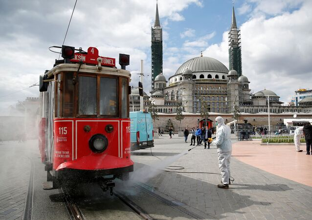 A municipality worker sprays disinfectant over a tram to prevent the spread of coronavirus disease (COVID-19) in central Istanbul, Turkey, March 18, 2020