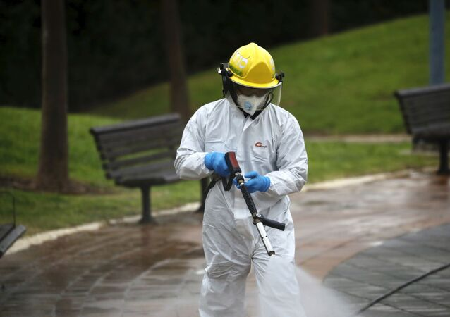 An Israeli firefighter sprays disinfectant in Modi'in, Israel