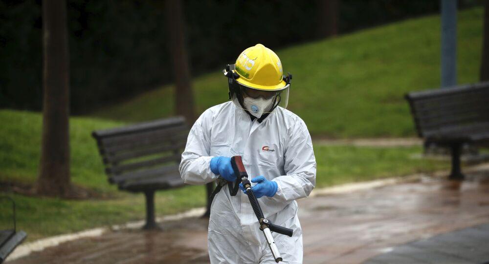 An Israeli firefighter sprays disinfectant in Modi'in, Israel