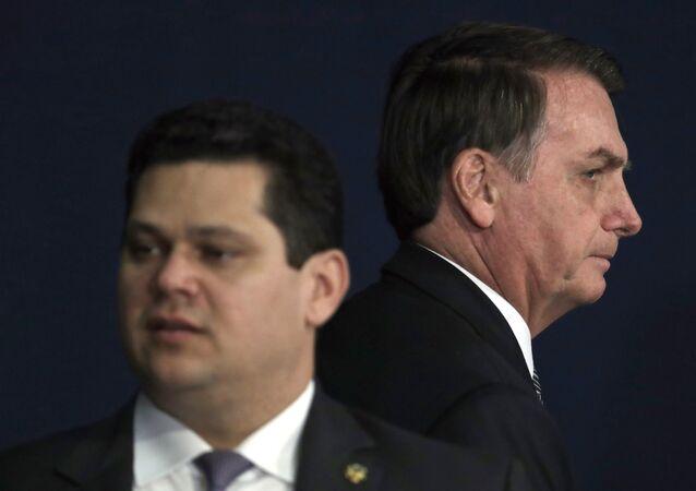 Brazil's President Jair Bolsonaro, right, walks behind the President of the Brazilian National Congress Davi Alcolumbre, during the presentation of the Brazil's new attorney general Augusto Aras, in Brasilia, Brazil, Oct. 2, 2019