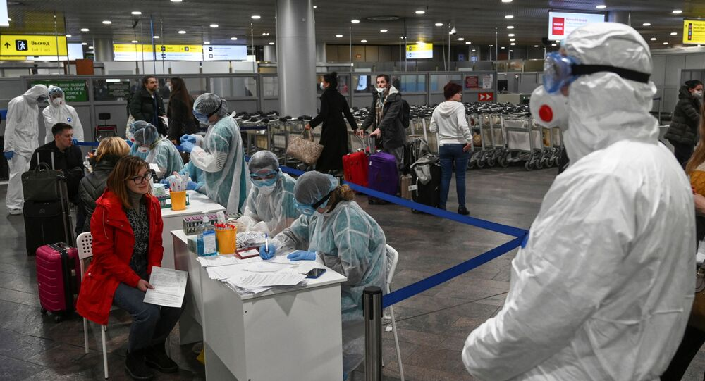 Russian officials and medical staff at Sheremetyevo International Airport outside Moscow