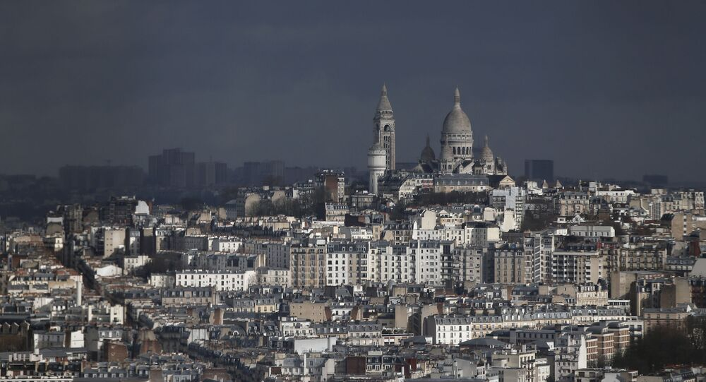 View of Montmartre hill, with Sacre Coeur Basilica, in Paris, 27 March 2018