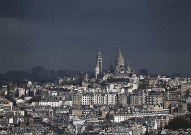 View of the Montmartre hill, with the Sacre Coeur Basilica, in Paris, Tuesday, March 27, 2018