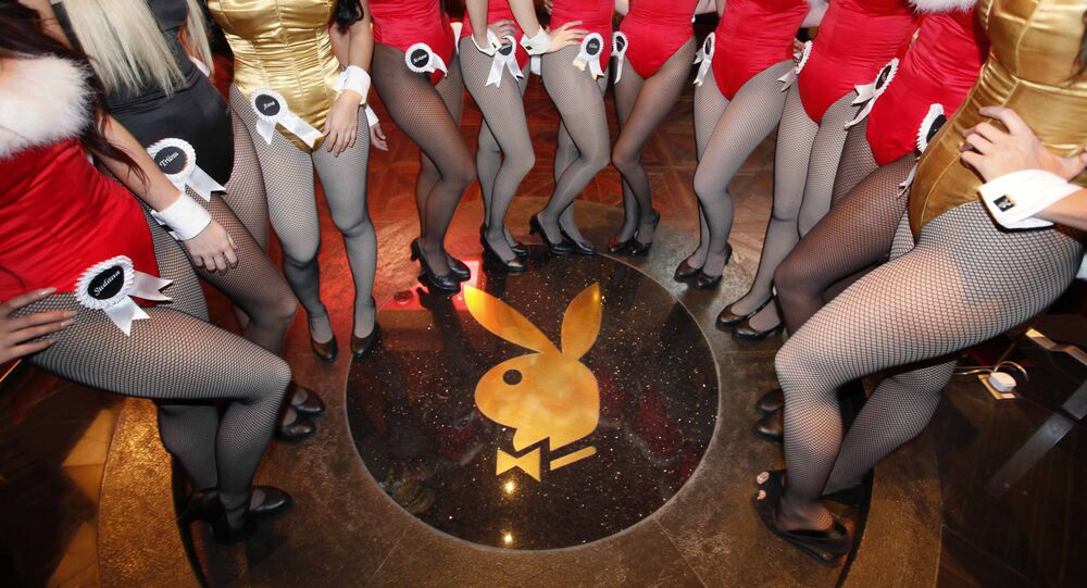 FILE - In this Dec. 18, 2010 file photo, waitresses pose inside the Playboy Club at the Sands Casino in Macau