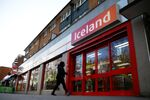 People enter an Iceland store in London, Britain. Picture taken March 2, 2020