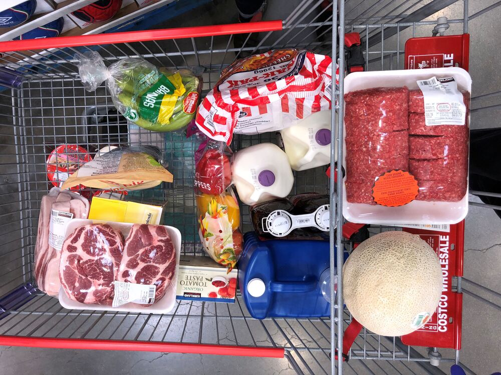 A customer's cart filled with the supplies they're purchasing in response to news about coronavirus disease (COVID-19) at Costco Wholesale on Still Creek Drive in Burnaby, British Columbia