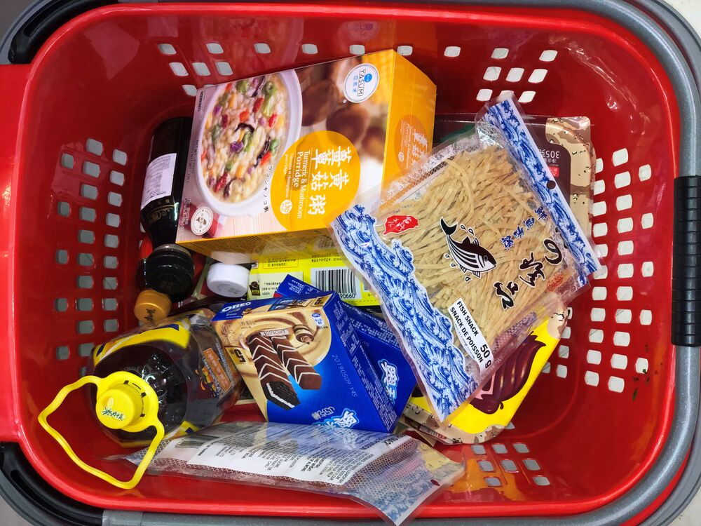 A customer's cart filled with the supplies they're purchasing in response to news about coronavirus disease (COVID-19) at FoodyWorld on Sexsmith Drive in Richmond, British Columbia, Canada