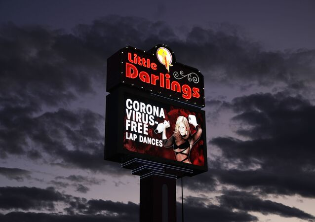 A sign at a strip club advertises coronavirus-free lap dances Friday, March 13, 2020, in Las Vegas