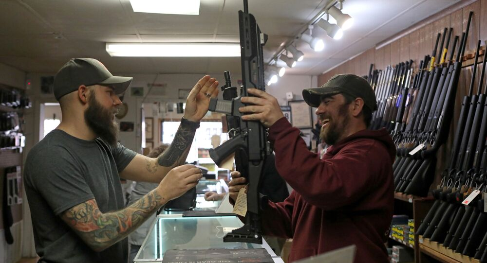 Customers handle semi-automatic rifles at Frontier Arms & Supply gun shop amid fears of the global growth of coronavirus disease (COVID-19) cases, in Cheyenne, Wyoming, U.S. March 18, 2020