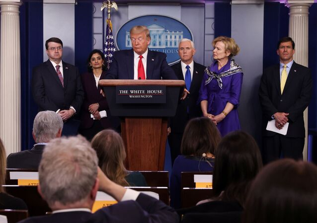 U.S. President Donald Trump attends the daily coronavirus response briefing as members of the administration's coronavirus task force standby at the White House in Washington, U.S., March 18, 2020.