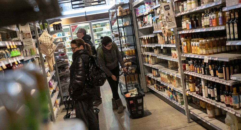 Customers shop in a store following the outbreak of coronavirus disease (COVID-19), in New York City, U.S., March 16, 2020.