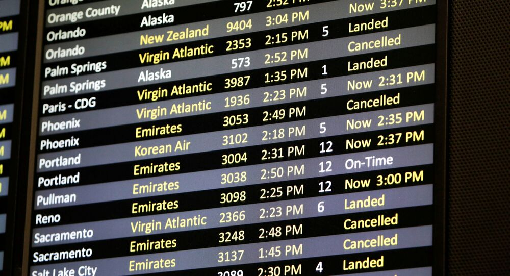 Several canceled flights are pictured on a monitor at Seattle-Tacoma International Airport as airlines are reeling from a plunge in bookings and traffic, as the fast-spreading coronavirus pandemic has prompted travel restrictions and event cancellations around the world, 13 March 2020
