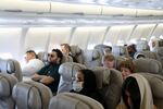 Passengers wear protective face masks following an outbreak of coronavirus, on a plane of Saudi Airlines, during their trip to al-Ula to attend the Tantura Festival, Saudi Arabia March 6, 2020