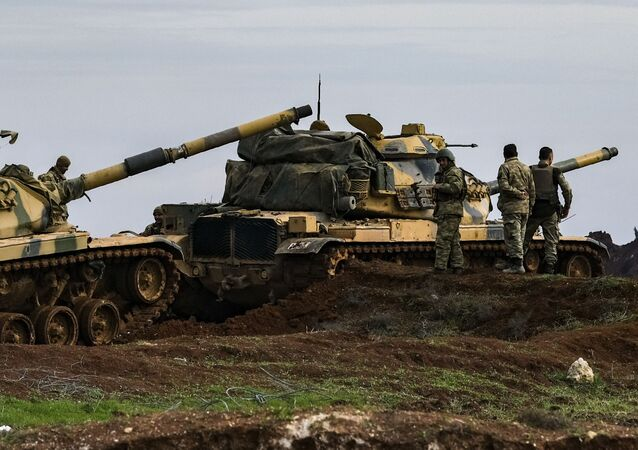 Turkish army tanks stationed in the east of Idlib, Syria, Saturday, Feb. 15, 2020