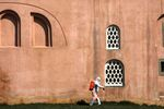 A worker in protective suit disinfects the wall of a mosque in response to the spreading coronavirus disease (COVID-19) in Istanbul,Turkey March 20, 2020