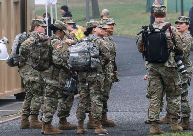 U.S. army soldiers arrive to cooperate at a new drive-thru coronavirus disease (COVID-19) testing center at Bergen Community College in Paramus, New Jersey, U.S., March 20, 2020