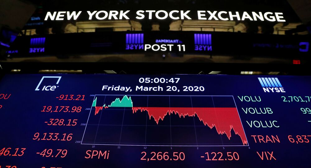 The final numbers of the day are displayed above the floor of the New York Stock Exchange (NYSE) stands empty as the building prepares to close indefinitely due to the coronavirus disease (COVID-19) outbreak in New York, U.S., March 20, 2020
