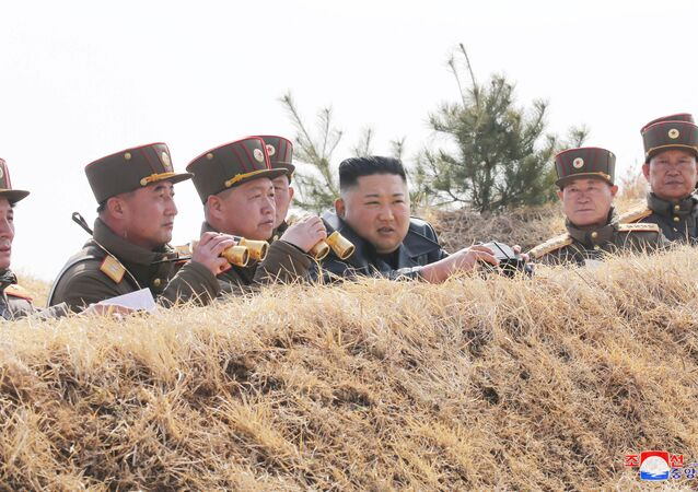 North Korean leader Kim Jong Un guides artillery fire competition in this image released by North Korea's Korean Central News Agency (KCNA) on March 20, 2020