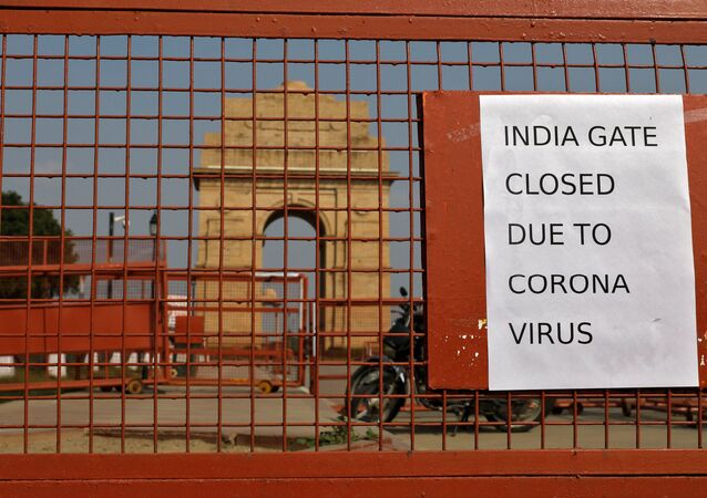 A sign pasted on a security barricade is seen after the India Gate war memorial was closed for visitors amid measures for coronavirus prevention in New Delhi, India, March 19, 2020.
