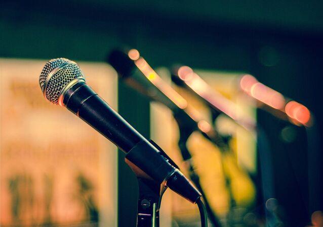 Microphones are seen in music studio