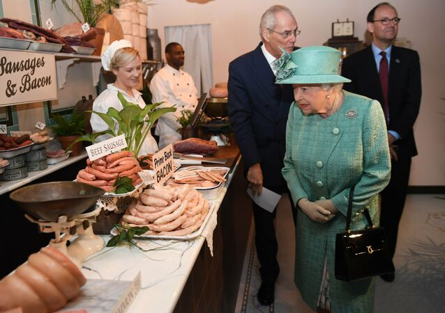 Britain's Queen Elizabeth II visits a replica of one of the original Sainsbury's stores in London