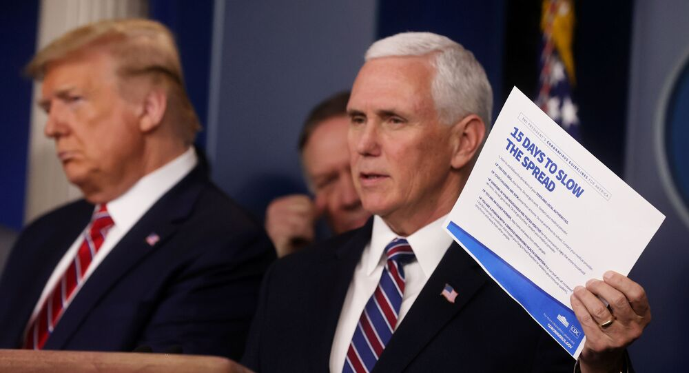 U.S. President Donald Trump and Secretary of State Mike Pompeo listen as Vice President Mike Pence addresses the Trump administration's daily coronavirus task force briefing while holding up a chart reading 15 Ways to Slow the Spread at the White House in Washington, U.S., March 20, 2020
