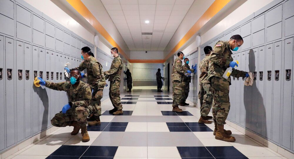 Soldiers From New York Army and Air National Guard work to sanitize the New Rochelle High School